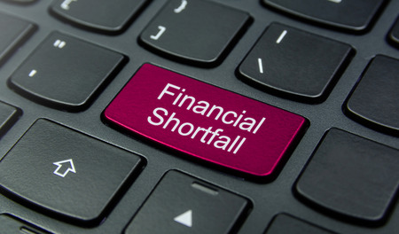 shortfall: Close-up the Financial Shortfall button on the keyboard and have Magenta color button isolate black keyboard