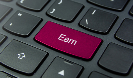 earn: Close-up the Earn button on the keyboard and have Magenta color button isolate black keyboard