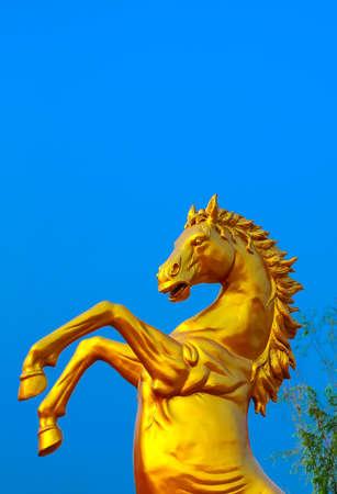 Gold horse statue photo