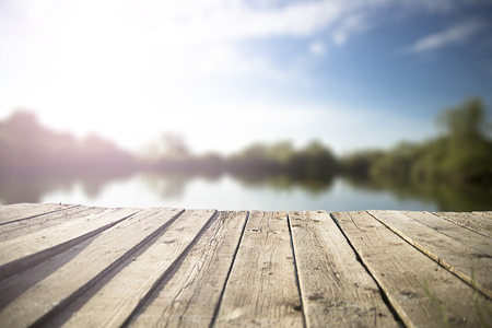 relaxation background: old wooden pier on the  lake.