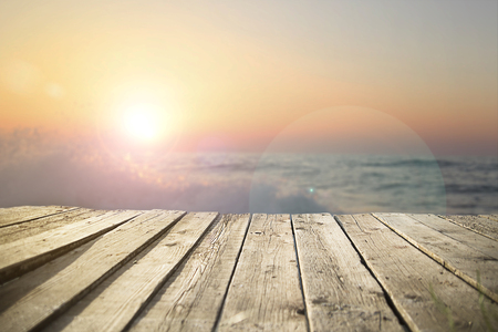sunshine background: old wooden pier on the sea in  sunset