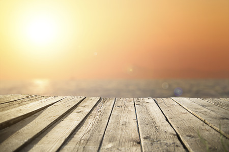 old wooden pier on the sea in  sunset