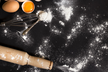 mess: Cooking ingredients on a black background.