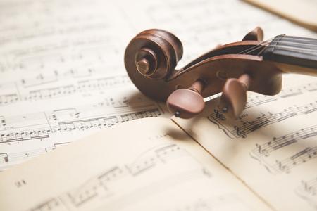 of mozart: Vintage violin on the  sheet music.