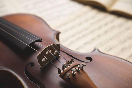 stradivarius: Vintage violin on the  sheet music.