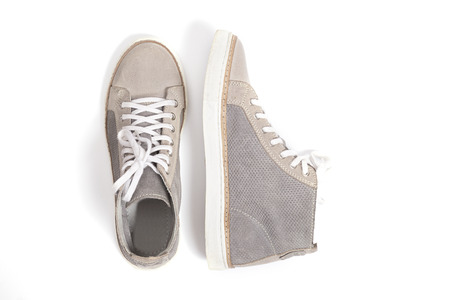new gray sneakers isolated on white background. Foto de archivo