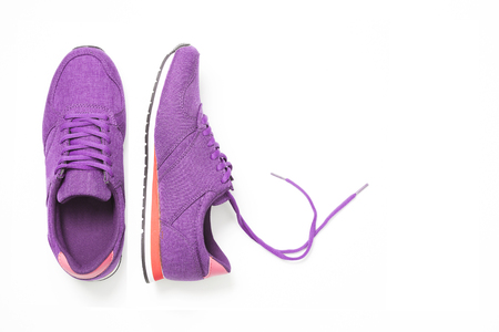 pair of new purple sneakers isolated on white background.