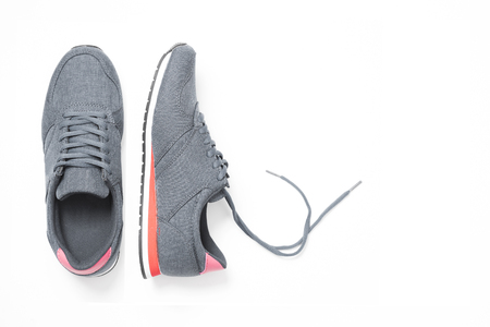 pair of new grey sneakers isolated on white background.