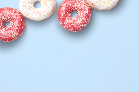 delicious sweet donuts on the blue background.