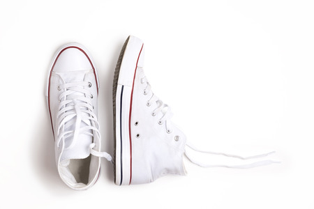 Pair of new white sneakers isolated on white background. Stock Photo
