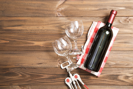 bottle of wine with wine glass on white wooden background. Stock Photo