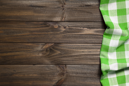 Green napkin on the old wooden table. Stock Photo