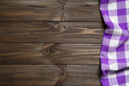Purple napkin on the old wooden table. Stock Photo