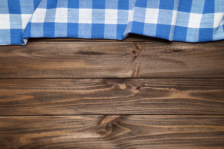 Blue napkin on the old wooden table. Standard-Bild