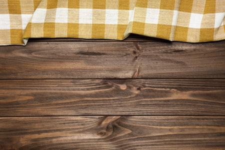 Orange napkin on the old wooden table. Standard-Bild
