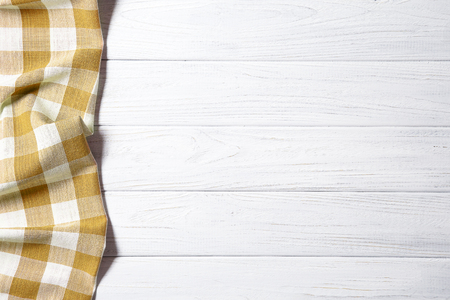 Yellow napkin on the old wooden table.