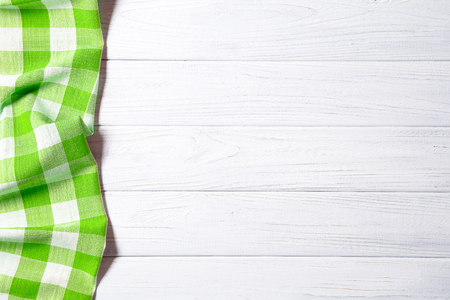 Green napkin on the old wooden table. Standard-Bild