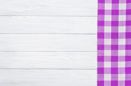 Purple napkin on the old wooden table. Banque d'images