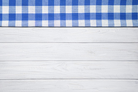 Blue napkin on the old wooden table. Stock Photo