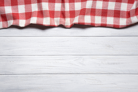Red napkin on the old wooden table.