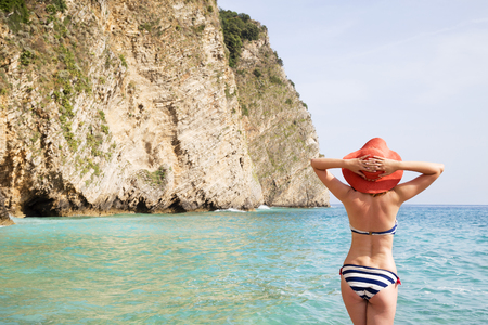 Young beautiful woman sunbathing on the sea Standard-Bild