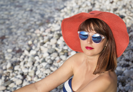 Young beautiful woman sunbathing on the sea Stock Photo