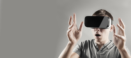 Young man in virtual reality, vr glasses. Stock Photo
