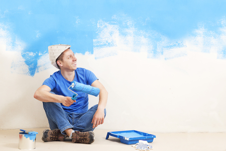 the painter paint the wall of the room.