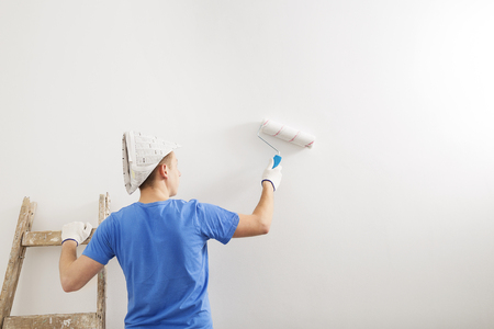 the painter whitewashed the wall of the room.