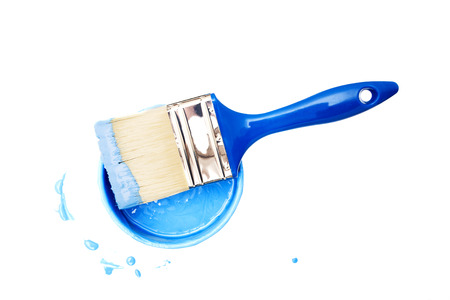 paint bucket and paintbrush on a white backdrop.