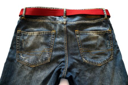 folded clothes: Jeans and red belt