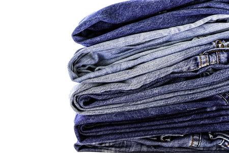 blue jeans: Stack of blue jeans on white background
