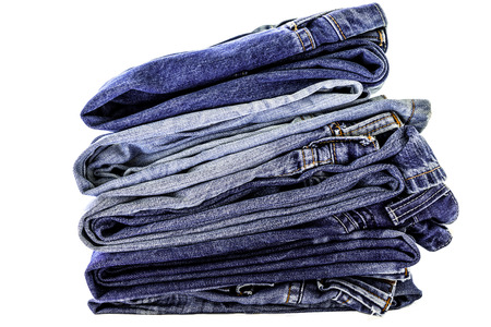 folded clothes: Stack of blue jeans on white background