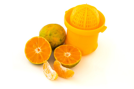 extractor: juice extractor with oranges isolated on white background