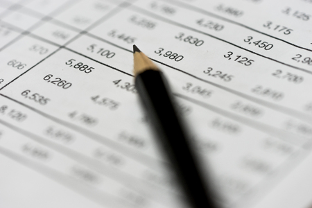 financial statement: pencil on financial statement on accountants desk Stock Photo