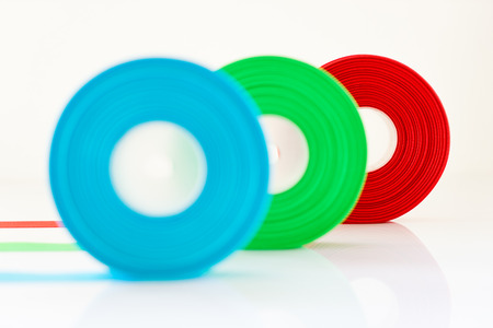 loot: Red Green Blue ribbon Roll isolated on white background , Select focus on red