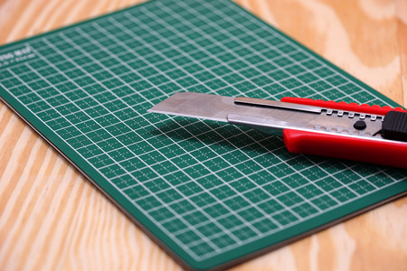 cutter: cutter on green cutting mat