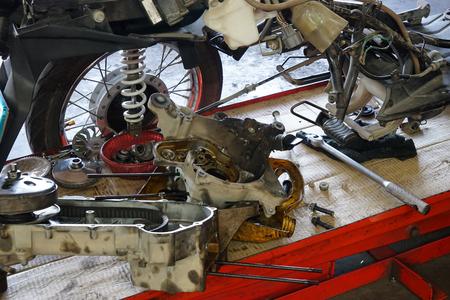 motorcycle repair shop: framing of a motorcycle in repair of the damage,Garage shop
