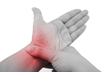 wrist pain: Pain in a wrist. holding hand to spot of wrist pain. Stock Photo