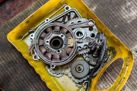 motorcycle repair shop: Part of a motorcycle engine in repair of the damage,Garage shop