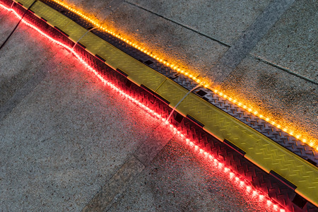bump: Rubber speed bump with light on a road , night time