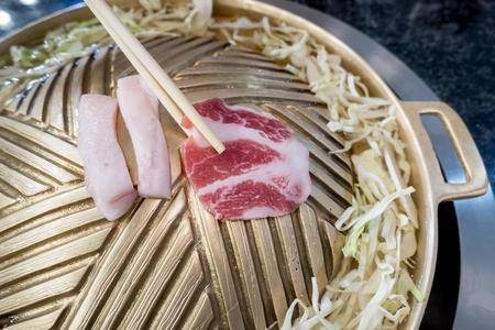 broil: pork slide on brass grilling pan