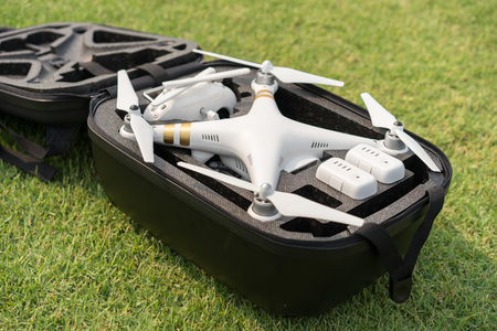 military watch: Drone in black backpack on grass