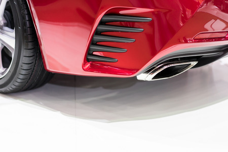 fumes: Exhaust fumes pipe of a red car