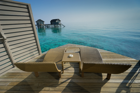 deck chairs: Two deck chairs on a sea view balcony at Maldives