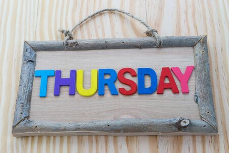 thursday: Thursday word with colorful letter on Wood Background