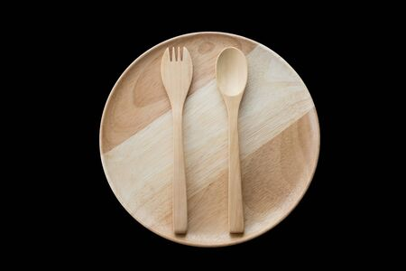 close up wooden dish ,spoon and fork on black background. top view Stock Photo
