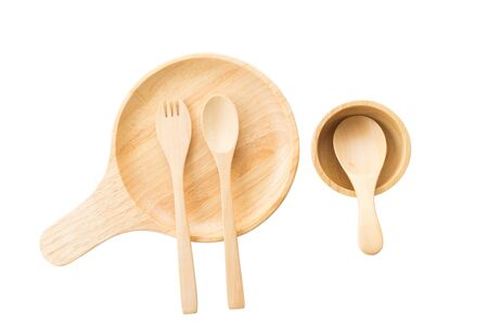 close up wooden dish ,spoon and fork on white background. top view