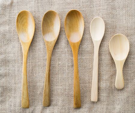 close up wooden spoon on gunny background