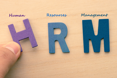 HRM letters (or Human Resources Management) Stock Photo